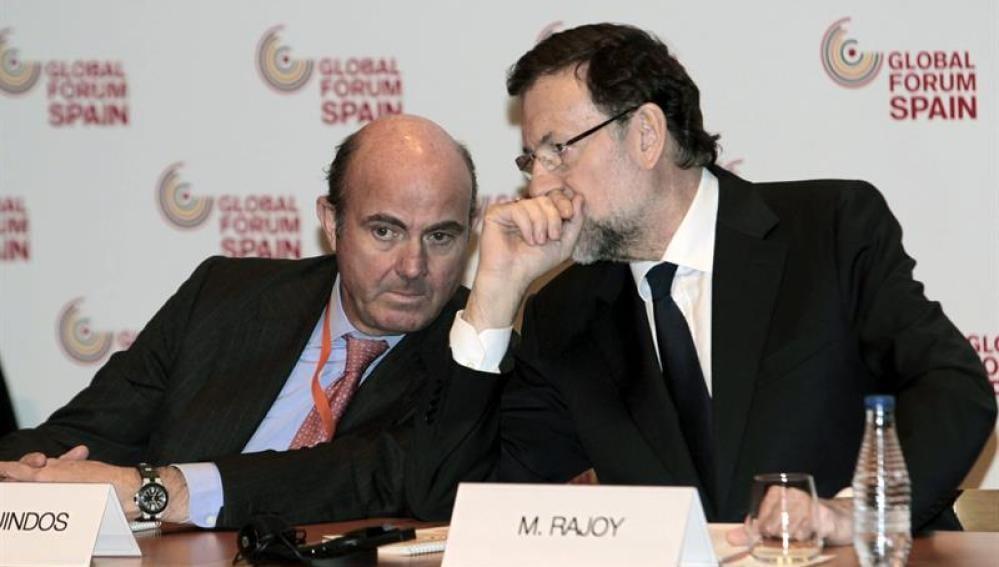Luis de Guindos y Mariano Rajoy