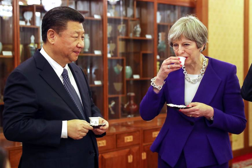 Xi Jinping y Theresa May